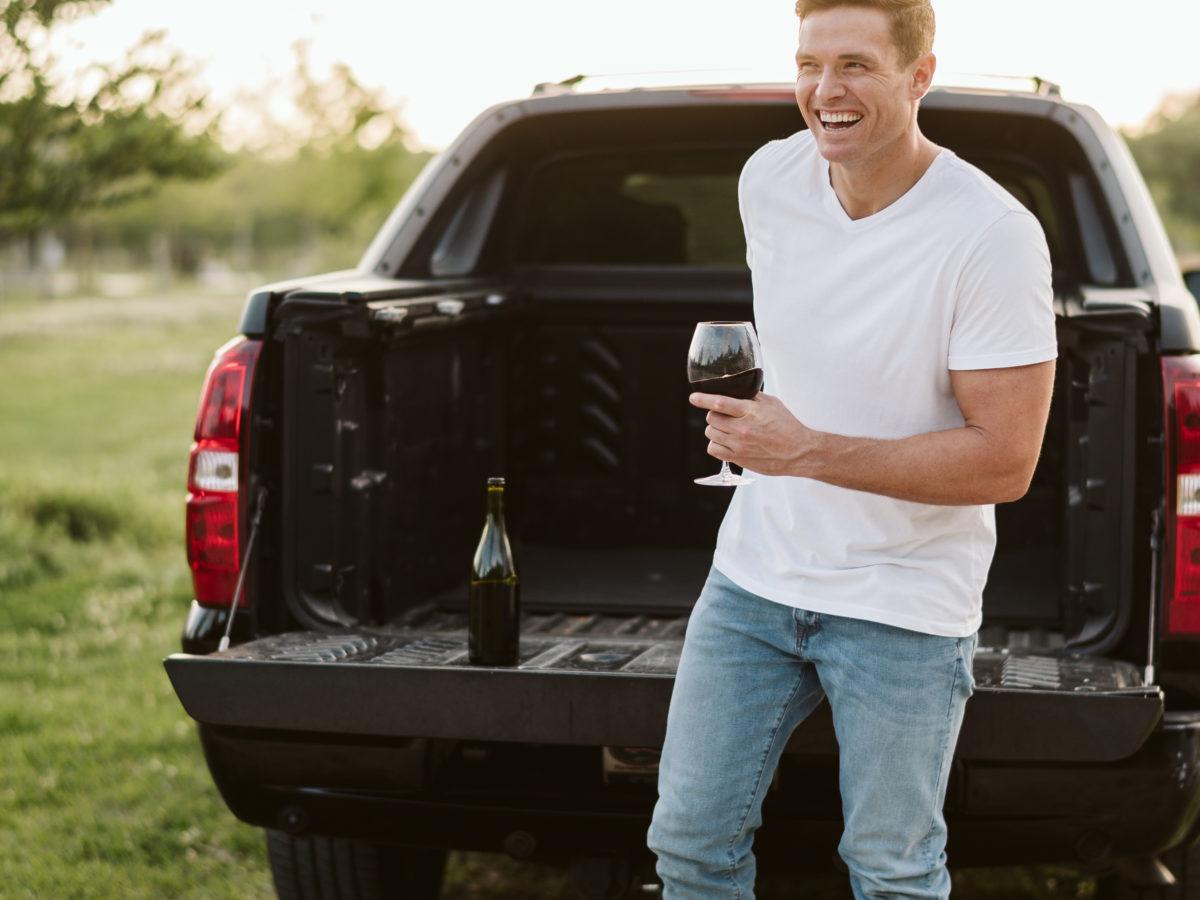 Justin Root Drinking Wine Smiling